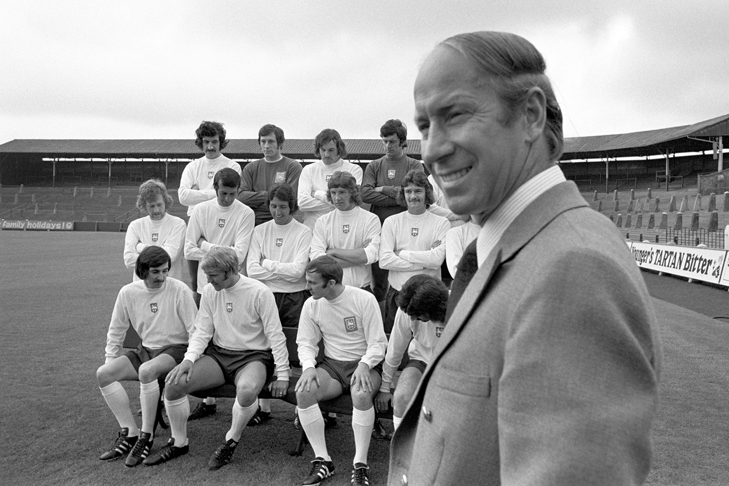 Bobby Charlton with his team