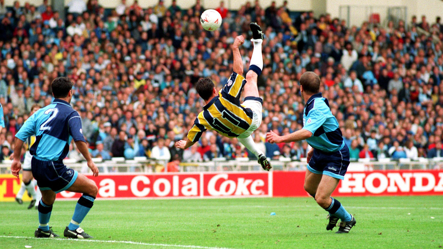 Ian Bryson scores an overhead kick at Wembley