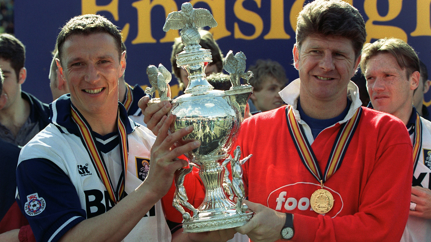 Skipper Ian Bryson and manager Gary Peters with the third division trophy in 1996