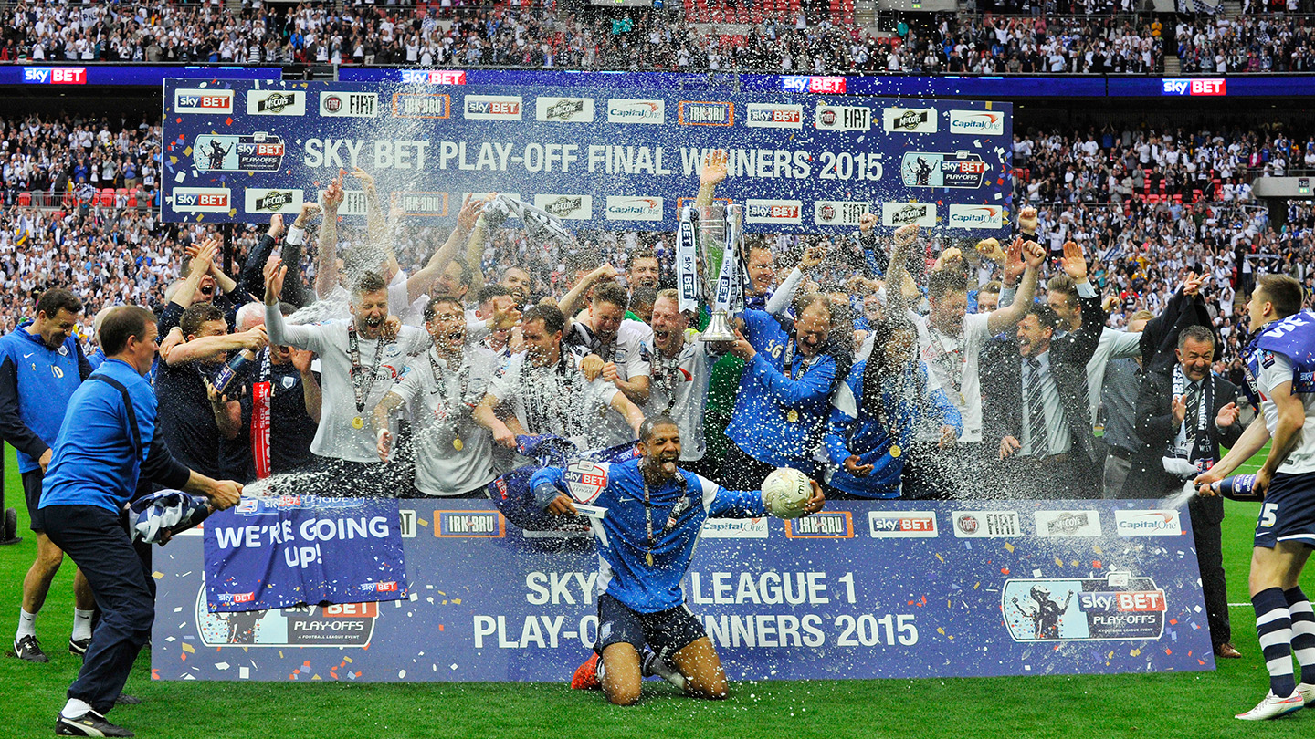 The team celebrate the League One Play-Off Final win at Wembley on 24th May 2015